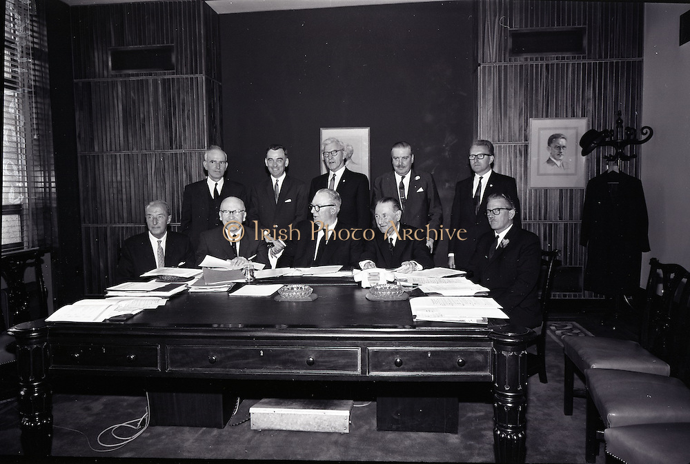 9/06/1965<br /> 06/29/1965<br /> 29 June 1965<br /> New Ireland Assurance Co. Ltd., AGM at New Ireland Buildings, 12 Dawson Street, Dublin. Picture shows seated (l-r): Mr. M.J. Campbell, P.C.; Padraig Ó Nuallaín, B.A., B.Comm., A.C.A., Secretary; Mr. M.L. Ó Raghallaigh, LL.D., P.C., F.C.I.I., Chairman and Managing Director; Mr. Francis J. Thornton, General Manager; Mr. B.E. O'Reilly, Manager. Standing (l-r): Mr. C.R. Ross, Actuary; Mr. Mairtin McCullough; Mr. L.S. Ó Ríordaín; Mr. Liam O'Reilly and Mr. M.J. Campbell P.C. at the Annual General Meeting.