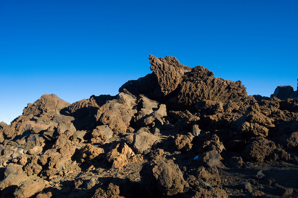 Lava fields in The Teide volcano (the highest mountain of Spain, 3.718 m), at sunrise. Teide National Park, Tenerife Island, Canary Islands, Spain.