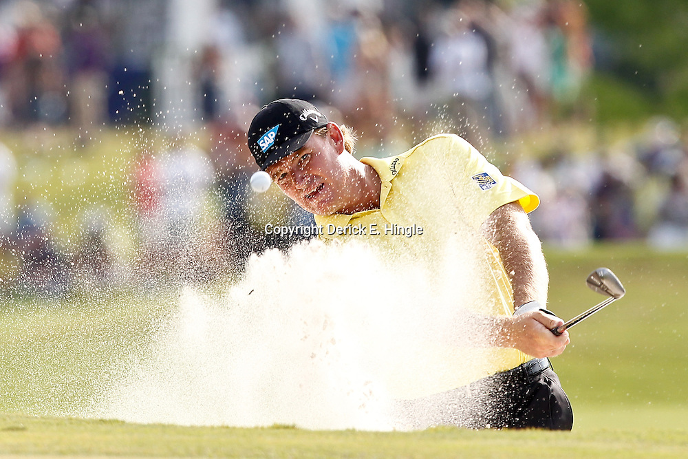 Apr 29, 2012; Avondale, LA, USA; Ernie Els hits from a bunker on the first playoff at the 18th hole during the final round of the Zurich Classic of New Orleans at TPC Louisiana. Mandatory Credit: Derick E. Hingle-US PRESSWIRE