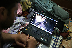 An activist shows a video to a photographer of a killed person by the Syrian regime after being tortured to death in one of their bases where they prepare demonstrations and slogans in Atareb, 30km west of Aleppo, on April 26, 2012. Photo by Daniel Leal-Olivas / i-Images...