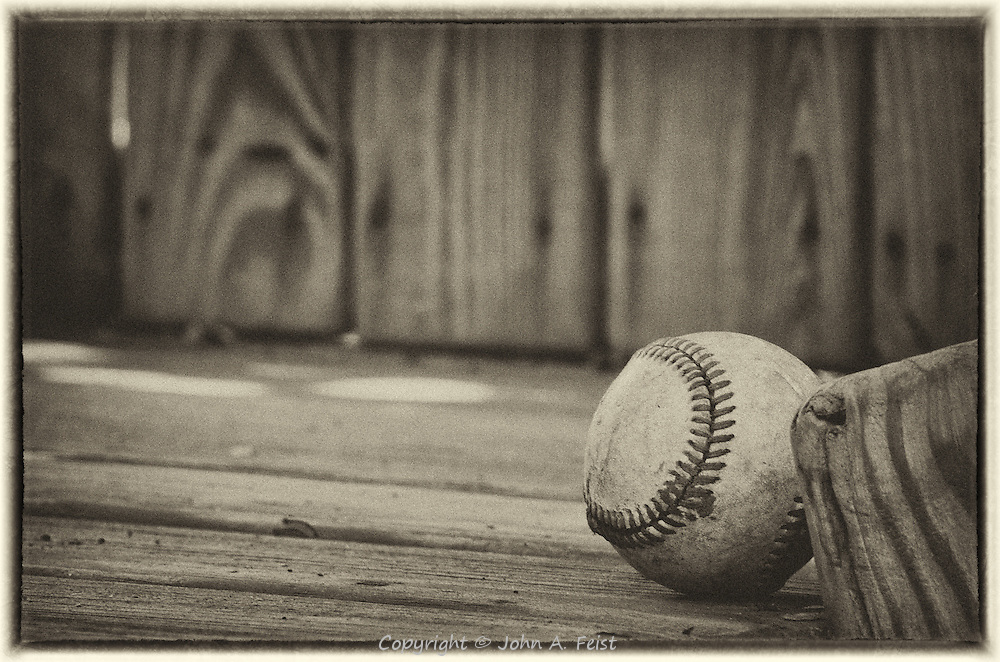 A closer look at the baseball wedged against the top of the ladder in the playhouse.