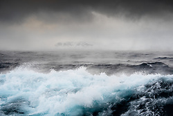 Stormy ocean on the western coast of Spitsbergen, Svalbard in March