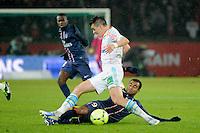 FOOTBALL - FRENCH CHAMPIONSHIP 2012/2013 - L1 - PARIS SAINT GERMAIN v OLYMPIQUE MARSEILLE - 24/02/2013 - PHOTO JEAN MARIE HERVIO / REGAMEDIA / DPPI - JOEY BARTON (OM) / LUCAS MOURA (PSG)