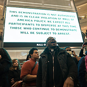 Danny Givens Jr. of Above Every Name Ministries in St. Paul, center, joins other clergy &amp; protestors associated with the Black Lives Matter movement as they stage a protest at the rotunda at the Mall of America in Bloomington, Minneapolis on December 20, 2014. <br />