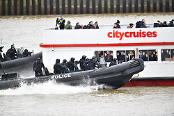 © Licensed to London News Pictures. 19/03/2017. London, UK. Police intercept a boat taken hostage by people playing armed  terrorists in an ant-terror training exercise takes place on The River Thames in  London. It is the first time that an exercise of this type has taken place on the river. Photo credit: Ben Cawthra/LNP