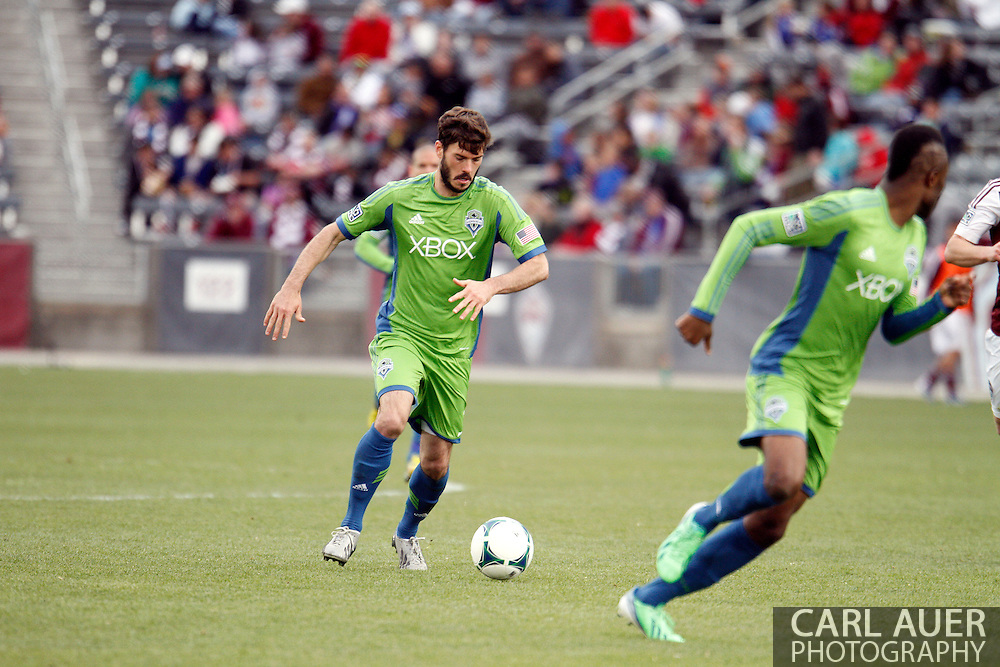 April 20th, 2013 Commerce City, CO - Seattle Sounders FC midfielder Brad Evans (3) brings the ball up the pitch in the second half of action in the MLS match between the Seattle Sounders FC and the Colorado Rapids at Dick's Sporting Goods Park in Commerce City, CO