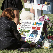 Memorial vigil for Aaron Feis and the 17 people killed at Marjory Stoneman Douglas High School by Nikolas Cruz using a semiautomatic AR-15 rifle. Mourners visit the 17 white crosses standing in a field in memory of each victim, 14 students and 3 faculty members. <br /> Photography by Jose More