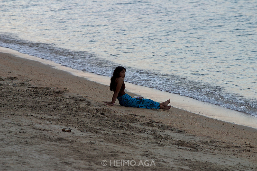 Girl enjoying sunset at Hat Bo Phut (beach).