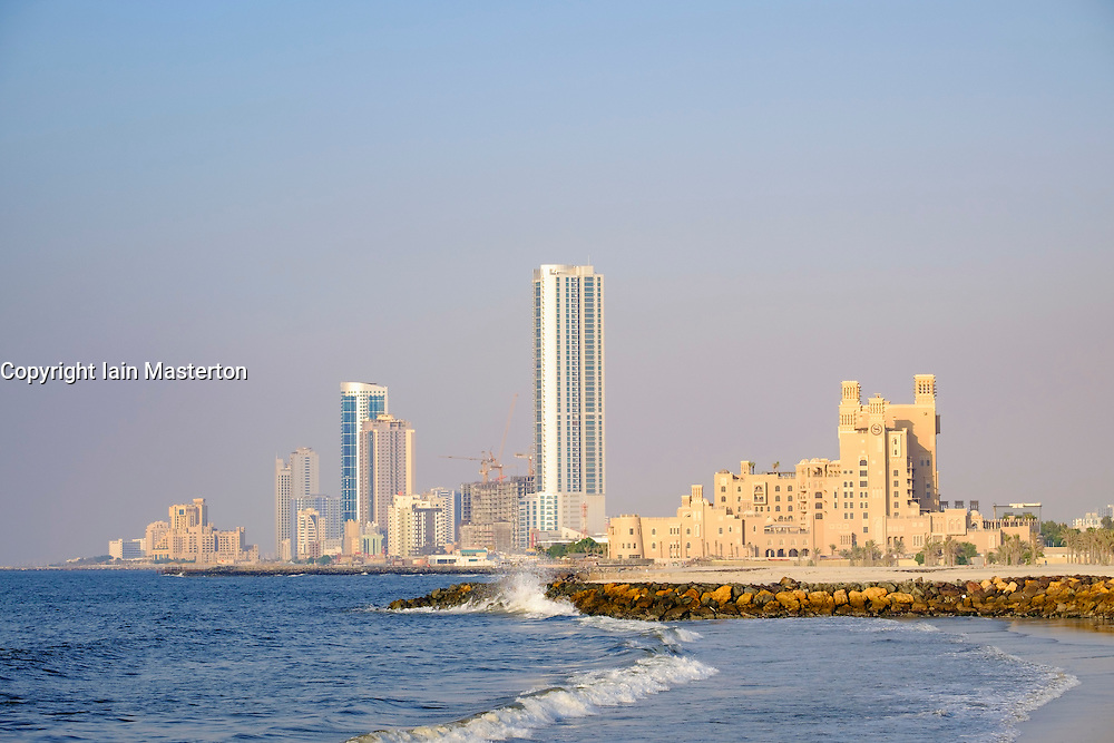 View of skyline along corniche waterfront of  Ajman emirate in United Arab Emirates