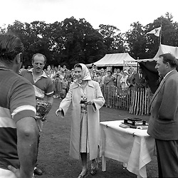 HM The Queen Elizabeth II with right, 3rd Viscount Cowdray at the Cowdray Gold Cup Polo, Cowdray Park, Midhurst, Sussex on 10th July 1960.