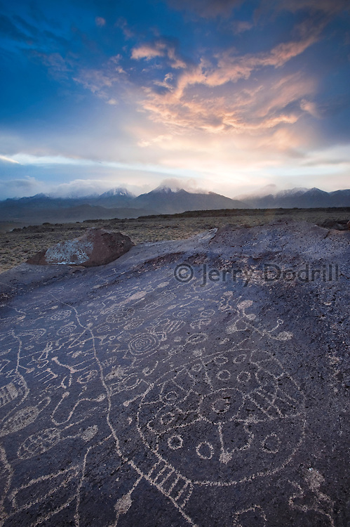 """The """"Sky Petroglyphs"""" are etched into a volcanic rock  surface in on the table lands outside Bishop California in the Owens Valley. Their age is unknown."""