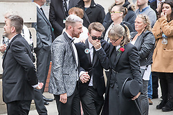 © Licensed to London News Pictures . 30/06/2017 . Stockport , UK . Mourners leave the Town Hall after the service . The funeral of Martyn Hett at Stockport Town Hall . Martyn Hett was 29 years old when he was one of 22 people killed on 22 May 2017 in a murderous terrorist bombing committed by Salman Abedi, after an Ariana Grande concert at the Manchester Arena . Photo credit : Joel Goodman/LNP