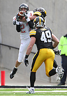 October 03, 2009: Arkansas State wide receiver Taylor Stockemer (27) pulls in a reception in front of Iowa cornerback Tyler Sash (9) and Iowa linebacker A.J. Edds (49) during the second half of the Iowa Hawkeyes' 24-21 win over the Arkansas State Red Wolves at Kinnick Stadium in Iowa City, Iowa on October 03, 2009.