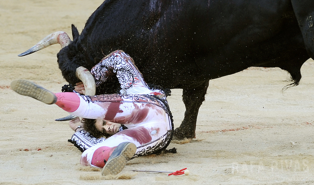 Spanish matador Miguel Abellan is attacked by his second Conde de la Corte fighting bull during the first corrida of the San Fermin festivities, on July 7, 2008, in Pamplona, northern Spain.