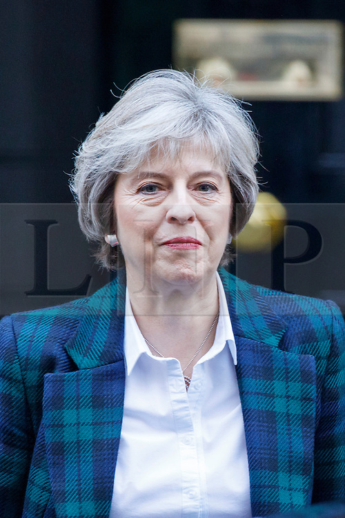 © Licensed to London News Pictures. 17/01/2017. London, UK. Prime Minister THERESA MAY leaves Downing Street to deliver her much anticipated Brexit plan speech after a cabinet meeting on Tuesday, 17 January 2017. Photo credit: Tolga Akmen/LNP