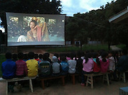 "ZHANGZHOU, CHINA - (CHINA OUT) <br /> <br /> ""Movie Theater"" In Rural China <br /> <br /> Students watch outdoor movies at Yunhua Primary School  in Dali, Yunnan Province of China. There are many movie projectionists working in rural areas to show movies for farmers.<br /> ©Exclusivepix"