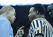 January 14, 2011: Michigan Wolverines head coach John Beilein argues a call with Official Ed Hightower during the NCAA basketball game between the Michigan Wolverines and the Iowa Hawkeyes at Carver-Hawkeye Arena in Iowa City, Iowa on Saturday, January 14, 2011. Iowa defeated Michigan 75-59.