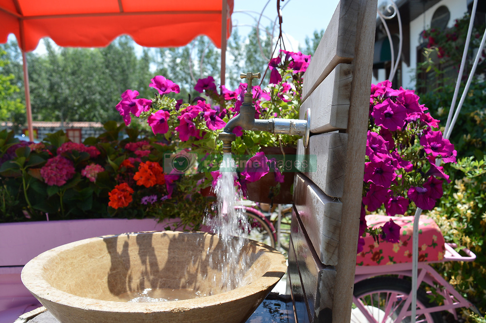 June 27, 2017 - Ankara, Turkey - Flowers are seen at Cheerful Village in Ankara, Turkey on June 27, 2017. Mostly families and children visit the village to enjoy the holiday on the last day of Eid al-Fitr. (Credit Image: © Altan Gocher/NurPhoto via ZUMA Press)
