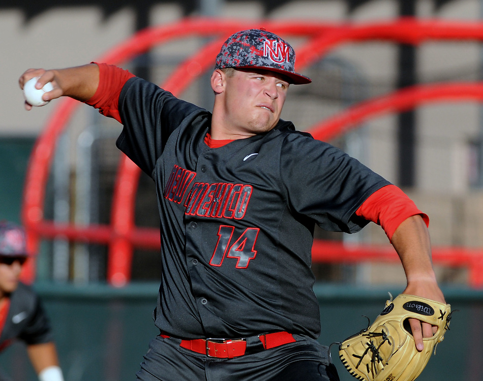 jt052517d/sports/jim thompson/ UNM's pitcher  #14Tyler Stevens sends the heat over the plate in their game against Nevada Thursday night. Thursday May. 25, 2017. (Jim Thompson/Albuquerque Journal)