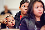 19 DECEMBER 2010 - PHOENIX, AZ: A woman comforts her child at a prayer service for the DREAM Act in Phoenix. About 100 supporters of the DREAM Act gathered at First Congregational Church of Christ in Phoenix Sunday night, December 19, for a prayer vigil in support of the DREAM Act, which was defeated in the US Senate Saturday, Dec. 18. The DREAM Act, was supported by the Obama administration, and was an important part of the administration's immigration reform platform. The defeat of the DREAM Act, which would have established a path to citizenship for undocumented immigrants who were brought to the US by their parents when they were children, set back the President's immigration reform efforts.  PHOTO BY JACK KURTZ