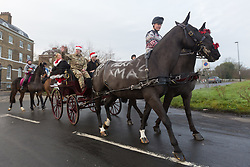 © Licensed to London News Pictures. 24/12/2018. Blackheath, UK. Members of the King's Troop Royal Horse Artillery have taken part in their traditional Christmas Eve ride from their barracks in Woolwich to Blackheath. Photo credit : Rob Powell/LNP