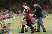 Ex-Japanese prisoner of War, Roy Welland (94) walks with a parachute regiment soldier through the graves of fallen servicemen during the Remembrance Day ceremonies at the Commonwealth War Cemetery in Hodogaya, Yokohama, Japan. Wednesday November 11th 2015