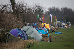 © Licensed to London News Pictures . 24/01/2014 . Barton Moss Road , Manchester , UK . Tents pictched alongside the Barton Moss Road , the access road leading to the iGas site . Site of a protest camp on Barton Moss Road where anti-fracking demonstrators are based on an access road leading to an iGas fracking site as today (24th January 2014) Greater Manchester Police announce two further arrests from the ongoing protest after reporting that a security guard was threatened and assaulted on Barton Moss Road on Monday (20th January 2014) . Photo credit : Joel Goodman/LNP