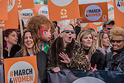 Thousands join CARE International's #March4Women campaign in London celebrating International Women's Day.