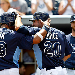 March 21, 2012; Port Charlotte, FL, USA; Tampa Bay Rays right fielder Matt Joyce (20) celebrates with teammates Carlos Pena following a two run homerun during the bottom of the second inning of a spring training game against the New York Yankees at Charlotte Sports Park.  Mandatory Credit: Derick E. Hingle-US PRESSWIRE