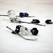Helmets, gloves and ice hockey sticks on the ice after the Iceland team's  victory during the Turkey v Iceland match at the 2012 IIHF Ice Hockey World Championships Division 3 held at Dunedin Ice Stadium. Dunedin, Otago, New Zealand. 17th January 2012. Photo Tim Clayton