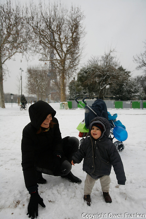 Paris in the snow, December 17, 2009<br /> <br /> Photograph by Owen Franken - a mother introduces her son to snow