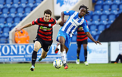 Peterborough United's Tommy Rowe in action with Colchester United's Marcus Bean - Photo mandatory by-line: Joe Dent/JMP - Tel: Mobile: 07966 386802 26/10/2013 - SPORT - FOOTBALL - Colchester Community Stadium - Colchester - Colchester United v Peterborough United - Sky Bet League One