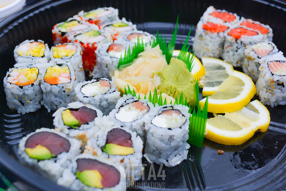 A colorful selection of delicious sushi is served for your enjoyment!