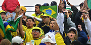 Brazilian race fans celebrate the victories of fellow countrymen Christian Fitipaldi and Roberto Moreno who took second and third place during the Freightliner/G.I. Joes 200 in Portland.