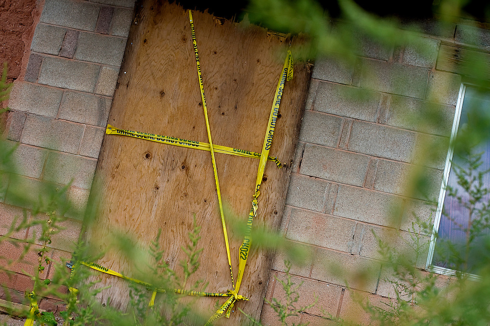 091709   Brian Leddy.The front door of Floyd Yuselew's home in Zuni is boarded shut and taped off.