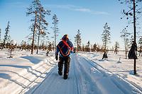 Nils Nutti wearing a traditional Sámi <br />  poncho called Luhkka