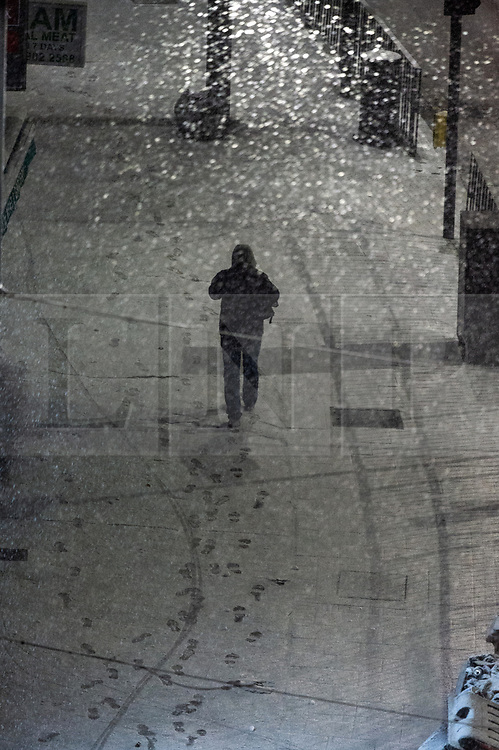 © Licensed to London News Pictures. 31/01/2019. London, UK. A man walks on the snow covered streets of Wembley. Photo credit: Ray Tang/LNP