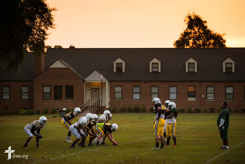 The mens football team practices during sunrise at Concordia College Alabama on Wednesday, August 20, 2014, in Selma, Ala.  LCMS Communications/Erik M. Lunsford