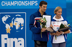 Michael Phelps of the United States and Federica Pellegrini of Italy receive an award after  the 13th FINA World Championships Roma 2009, on August 2, 2009, at the Stadio del Nuoto,  in Foro Italico, Rome, Italy. (Photo by Vid Ponikvar / Sportida)