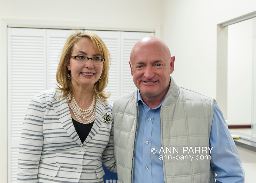 Garden City, New York, USA. 17th April 2016. GABBY GIFFORDS, former United States Congresswoman, and her husband MARK KELLY, former NASA astronaut, pose together after they each spoke about the importance of GOTV, Getting Out The Vote for Hillary Clinton - including because of Clinton's strong position on stricter gun control legislation - at the Canvass Kickoff at the Nassau County Democratic Office in Garden City. After Kelly then Giffords spoke, they posed for photos with volunteers who attended the campaign Official Event. Giffords survived an assassination attempt near Tuscon, Arizona, during her first 'Congress on Your Corner' event in January 2011. Kelly commanded the final flight of the Space Shuttle Endeavor in May 2011.