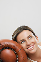 Young woman with head leaning against sofa