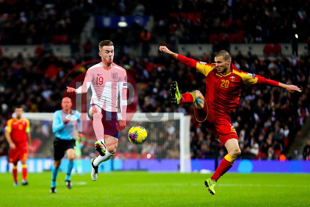 James Maddison of England is challenged by Aleksandar Sofranac of Montenegro - Rogan/JMP - 14/11/2019 - FOOTBALL - Wembley Stadium - London, England - England v Montenegro - UEFA Euro 2020 Qualifiers.