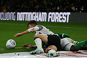 Derby County midfielder Jason Knight (38) & Sheffield Wednesday defender Moses Odubajo (22) during the EFL Sky Bet Championship match between Derby County and Sheffield Wednesday at the Pride Park, Derby, England on 11 December 2019.