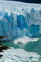 A massive chunk of ice calves from the face of the Perito Moreno Glacier in Parque Nacional Los Glaciares, near El Calafate, Argentina. The southern Patagonian ice field (Campo de Hielo Patagonico Sur) is the third largest concentration of fresh water in the world. The Perito Moreno is also one the only advancing glaciers left on Earth, creeping forward at a pace of around 2-3 meters per day and attracting hoards of tourists every year.