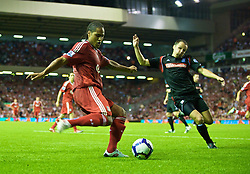 LIVERPOOL, ENGLAND - Wednesday, August 19, 2009: Liverpool's Glen Johnson crosses to David Ngog for Liverpool's fourth goal against Stoke City during the Premiership match at Anfield. (Pic by: David Rawcliffe/Propaganda)