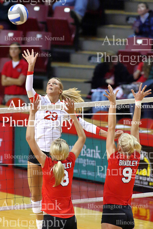 09 October 2009: Mallory Leggett strikes the ball towards Megan Schmidt and Skylar Lesan. The Redbirds of Illinois State defeated the Braves of Bradley in 3 sets during play in the Redbird Classic on Doug Collins Court inside Redbird Arena in Normal Illinois