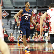 Malcolm Hill #21 of the Illinois Fighting Illini brings the ball up the court during the NIT First Round game at Agganis Arena on March 19, 2014 in Boston, Massachusetts . (Photo by Elan Kawesch)