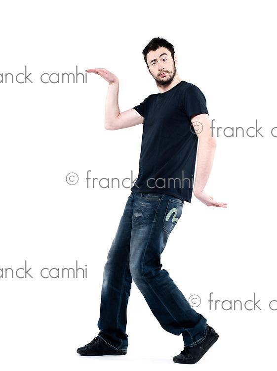 strange man attitude man on isolated white background walking like an egyptian