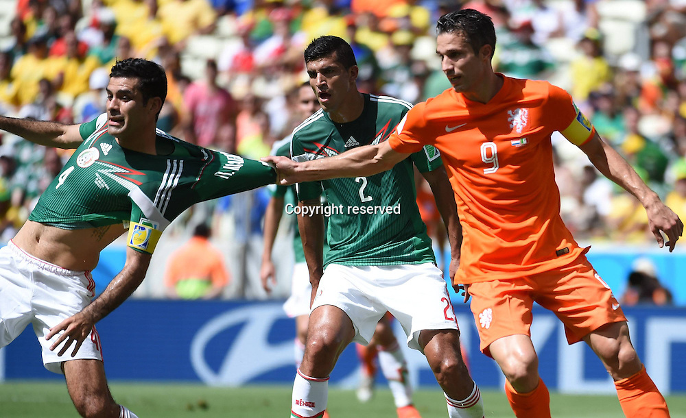 29.06.2014. Fortaleza, Brazil. Netherlands Robin van Persie (R) pulls back on the shirt of Mexicos Rafael Marquez during a Round of 16 match between Netherlands and Mexico of 2014 FIFA World Cup at the Estadio Castelao Stadium in Fortaleza, Brazil, on June 29, 2014.