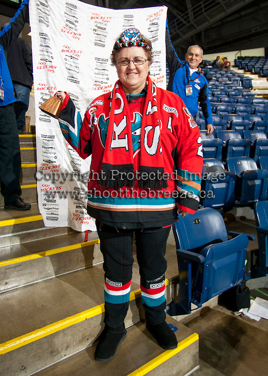 KELOWNA, CANADA - NOVEMBER 3:   A Kelowna Rocket fan shows her dedication and tries to win a trip to the Memorial Cup when the Prince George Cougars played the Kelowna Rockets on November 3, 2012 at Prospera Place in Kelowna, British Columbia, Canada (Photo by Marissa Baecker/Shoot the Breeze) *** Local Caption ***